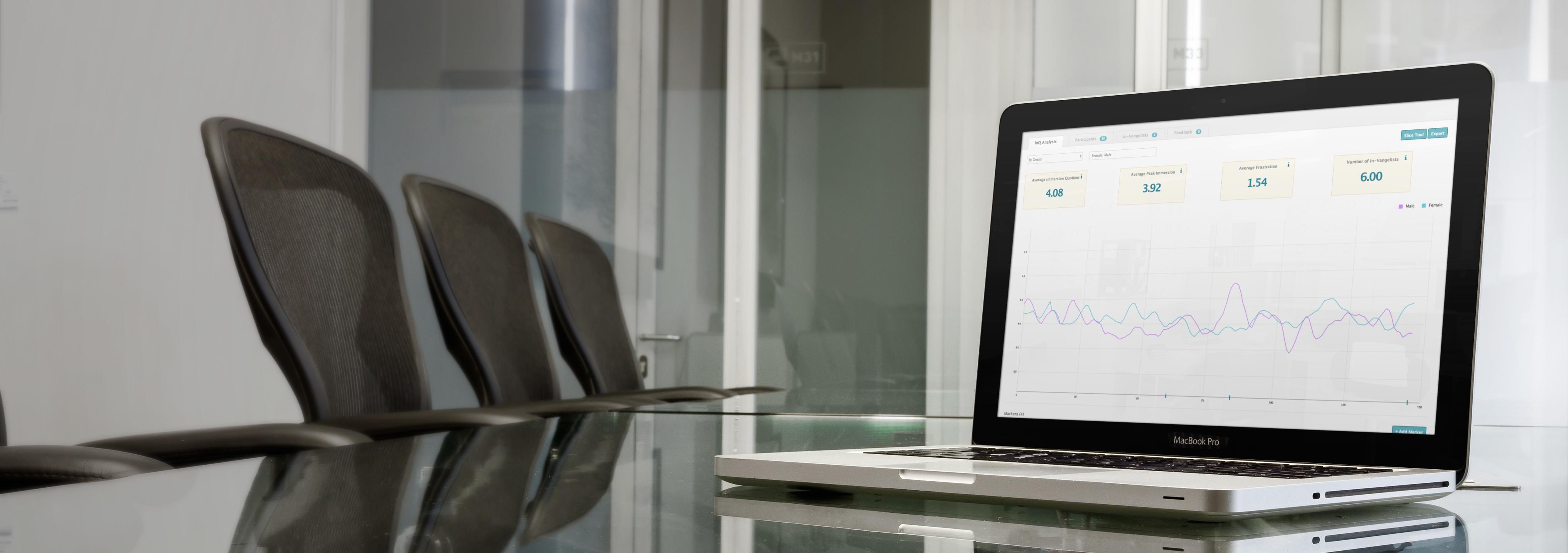 macbook-pro-over-glass-desk-in-business-room-wide